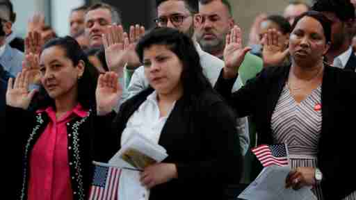 Immigrants take the Oath of Allegiance to become a U.S. citizens during an official Naturalization Ceremony at the Museum of Fine Arts, Boston in Boston, Massachusetts, U.S., May 6, 2019.   REUTERS/Brian Snyder - RC1FAA5D2010