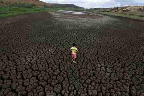 """Natan Cabral, 5, stands on the cracked ground of the Boqueirao reservoir in the Metropolitan Region of Campina Grande, Paraiba state, Brazil, February 13, 2017. REUTERS/Ueslei Marcelino             SEARCH """"BRAZIL DROUGHT"""" FOR THIS STORY. SEARCH """"WIDER IMAGE"""" FOR ALL STORIES. - RC1BC8B7DB20"""