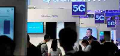 Signs of Qualcomm and 5G are pictured at Mobile World Congress (MWC) in Shanghai, China June 28, 2019. REUTERS/Aly Song - RC19526AED60