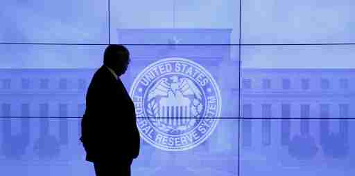A security guard walks in front of an image of the Federal Reserve following the two-day Federal Open Market Committee (FOMC) policy meeting in Washington, DC, U.S. on March 16, 2016. REUTERS/Kevin Lamarque/File Photo                 GLOBAL BUSINESS WEEK AHEAD PACKAGE Ð SEARCH ÒBUSINESS WEEK AHEAD SEPTEMBER 12Ó FOR ALL IMAGES - S1BEUAUFAYAC