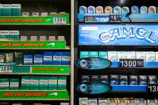 Newport and Camel cigarettes are stacked on a shelf inside a tobacco store in New York July 11, 2014. U.S. cigarette maker Reynolds American Inc is in talks to acquire rival Lorillard Inc in a multi-billion dollar deal that would reshape one of the world's biggest and most profitable tobacco markets, the companies said on Friday. In a statement confirming what people familiar with the matter previously told Reuters, Reynolds, No.2 player in the United States with brands including Camel and Pall Mall, said the talks were consistent with its strategy of weighing options that would help boost shareholder value. Buying Lorillard, which had a stock market value of $22.9 billion on Thursday, would give Reynolds the leading U.S. menthol cigarette Newport and its leading e-cigarette blu.Buying Lorillard, which had a stock market value of $22.9 billion on Thursday, would give Reynolds the leading U.S. menthol cigarette Newport and its leading e-cigarette blu. REUTERS/Lucas Jackson (UNITED STATES - Tags: BUSINESS) - GM1EA7C02A001