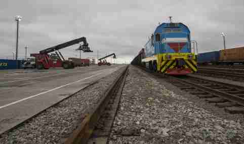 Railways and a container yard are seen at the Khorgos border crossing point, east of the country's biggest city and commercial hub Almaty, Kazakhstan, October 19, 2015. Kazakhstan wants to establish itself as a major trading hub between China and Europe and get a share of a $600 billion market, but it will have to end tough, often time-wasting, regulations that hurt its reputation as a cross-border trading partner. Picture taken October 19, 2015.  REUTERS/Shamil Zhumatov - GF20000033627