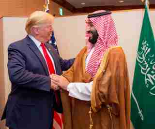 Saudi Arabia's Crown Prince Mohammed bin Salman shakes hands with U.S. President Donald Trump, at the G20 leaders summit in Osaka, Japan, June 29, 2019. Bandar Algaloud/Courtesy of Saudi Royal Court/Handout via REUTERS ATTENTION EDITORS - THIS PICTURE WAS PROVIDED BY A THIRD PARTY. - RC15CC524510