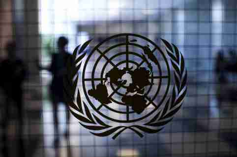 """A United Nations logo is seen on a glass door in the Assembly Building at the United Nations headquarters in New York City September 18, 2015. As leaders from almost 200 nations gather for the annual general assembly at the United Nations, the world body created 70 years ago, Reuters photographer Mike Segar documented quieter moments at the famed 18-acre headquarters on Manhattan's East Side. The U.N., established as the successor to the failed League of Nations after World War Two to prevent a similar conflict from occurring again, attracts more than a million visitors every year to its iconic New York site. The marathon of speeches and meetings this year will address issues from the migrant crisis in Europe to climate change and the fight against terrorism. REUTERS/Mike SegarPICTURE 13 OF 30 FOR WIDER IMAGE STORY """"INSIDE THE UNITED NATIONS HEADQUARTERS""""SEARCH """"INSIDE UN"""" FOR ALL IMAGES  - GF10000219225"""