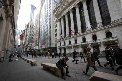 People walk by the New York Stock Exchange in New York's financial district March 11, 2014.  REUTERS/Brendan McDermid (UNITED STATES - Tags: BUSINESS) - GM1EA3C035U01