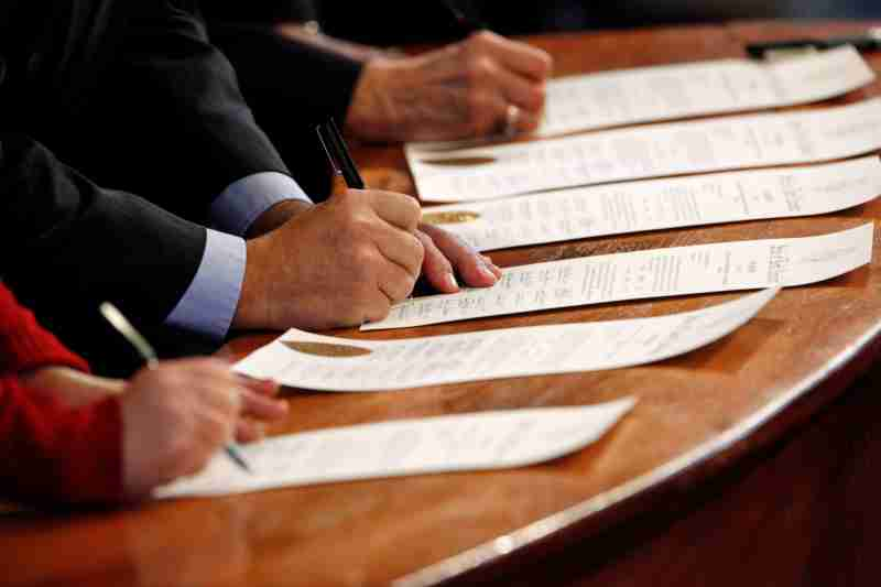 North Carolina Electoral College representatives sign the Certificates of Vote after they all cast their ballots for U.S. President-elect Donald Trump in the State Capitol building in Raleigh, North Carolina, U.S., December 19, 2016.     REUTERS/Jonathan Drake - RC12F8CC65F0