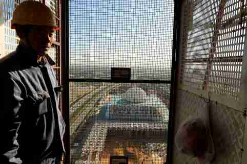 A Chinese worker uses the elevator of the 270-metre-high minaret at the construction site of the new Great Mosque of Algiers, called Djemaa El Djazair, which is being built by the China State Construction Engineering Corporation (CSCEC), and overseen by Algeria's National Agency for Realization and Management (ANERGEMA) in Algiers, Algeria February 7, 2017. REUTERS/Zohra Bensemra - RC190C8B5940
