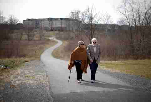 Retired couple Harvey and Cora Alter take a walk in their planned-community in semi-rural Frederick, Maryland March 2, 2012. Moving in retirement to save money - but not that far from previous homes, is a trend where retirees want to reduce the cost of living but not uproot their lives completely. Picture taken March 2, 2012. To match feature USA-RETIREES/     REUTERS/Jason Reed   (UNITED STATES - Tags: SOCIETY BUSINESS) - GM1E839043S01