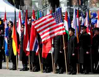 Lithuanian Military Academy students hold NATO membership states flags during the celebration of the the 15th anniversary of Lithuania's membership in NATO in Vilnius, Lithuania March 30, 2019. REUTERS/Ints Kalnins - RC1B87408B50