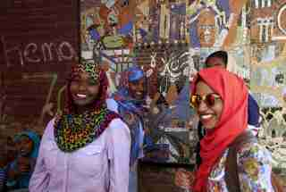 "Students laugh and share a joke outside their classroom at the Sudan University of Science and Technology in Khartoum, Sudan, May 14, 2015. In Sudan, which faces insurgences in the western region of Darfur and along its border with breakaway South Sudan, as well as double-digit inflation and high unemployment, life goes on for young people in the capital Khartoum. As well as studying, for those who can afford it, the urban young of Sudan play football and netball, swim and fish in the nearby River Nile, attend prayers at local mosques and enjoy concerts or family celebrations. Other entertainment includes watching U.K. football matches and films on TV, with Facebook being ever popular for chatting amongst friends. REUTERS/Mohamed Nureldin AbdallahPICTURE 11 OF 28 FOR WIDER IMAGE STORY ""YOUTH OF TODAY IN SUDAN"". SEARCH ""YOUNG NURELDIN"" FOR ALL IMAGES - GF10000121814"
