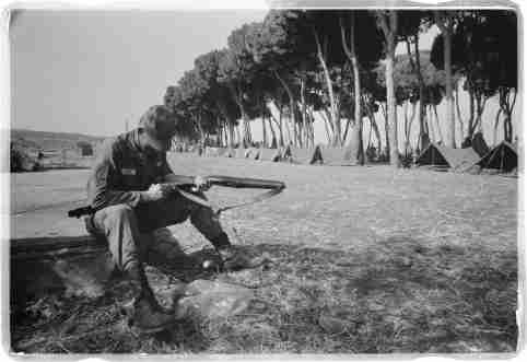 American paratrooper cleans his gun at Army base camp in Beirut, Lebanon. Credit: Library of Congress