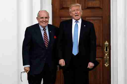 U.S. President-elect Donald Trump stands with former New York City Mayor Rudolph Giuliani before their meeting at Trump National Golf Club in Bedminster, New Jersey, U.S., November 20, 2016.  REUTERS/Mike Segar - S1AEUNZGGLAB