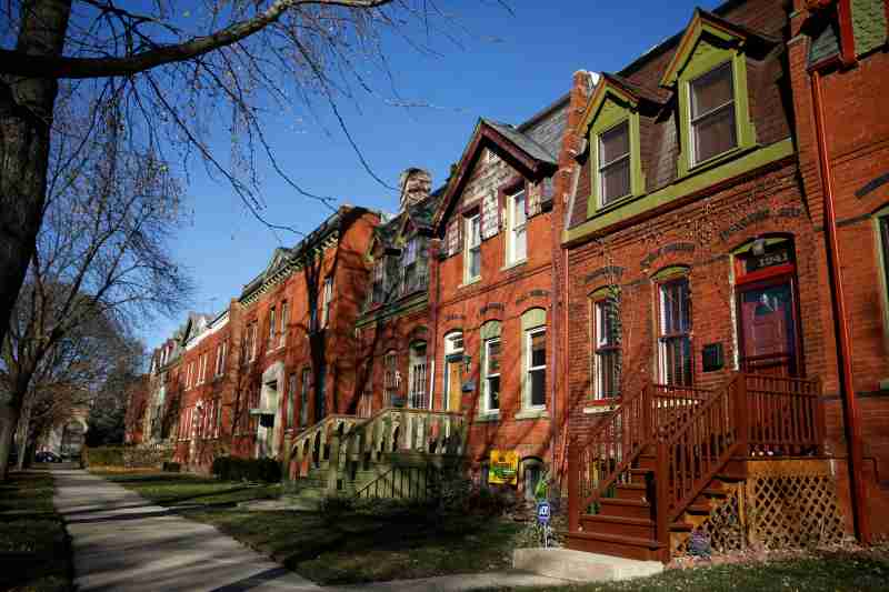 Row houses are seen in the historic Pullman neighborhood in Chicago November 20, 2014. U.S. President Barack Obama is expected to announce the designation of the Pullman neighborhood as a national park on February 19, according to park advocates. The neighborhood's brick homes and ornate public buildings were built in the 1800s by industrialist George Pullman as a blue-collar utopia to house workers from his sleeper car factory. Picture taken November 20, 2014.    REUTERS/Andrew Nelles (UNITED STATES - Tags: SOCIETY ENVIRONMENT POLITICS) - TM3EABN1EN001