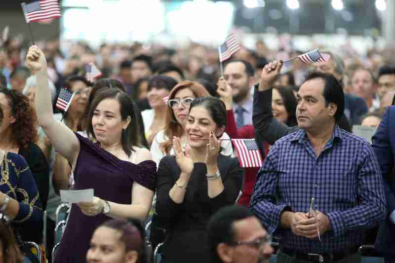 Immigrants are sworn in as new U.S. citizens at a naturalization ceremony in Los Angeles, California, U.S., August 22, 2019. REUTERS/Lucy Nicholson - RC1AFC189020