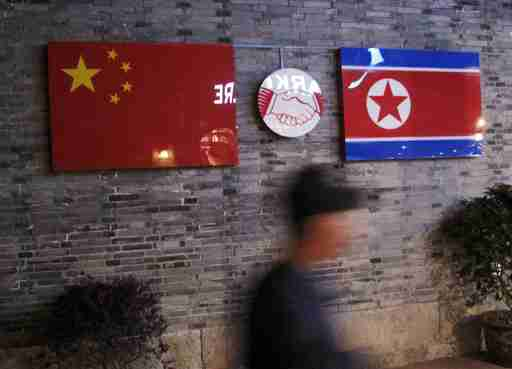 Flags of China and North Korea are seen outside the closed Ryugyong Korean Restaurant in Ningbo, Zhejiang province, China, in this April 12, 2016 file photo. REUTERS/Joseph Campbell/Files      TPX IMAGES OF THE DAY      - GF10000381375