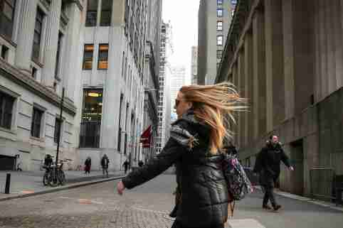 People walk on Wall St. during the morning commute in New York City, U.S., February 25, 2019.  REUTERS/Brendan McDermid - RC1CDFFF2A80
