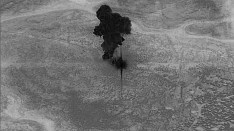 A smoke cloud rises moments after an air strike on the compound of Islamic State leader Abu Bakr al-Baghdadi in the Idlib region of Syria in a still image from video October 26, 2019. Video picture taken October 26, 2019.  U.S. Department of Defense/Handout via REUTERS. THIS IMAGE HAS BEEN SUPPLIED BY A THIRD PARTY. - RC179130A4B0