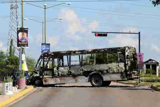 """The burnt wreckage of a bus is seen a day after cartel gunmen clashed with federal forces, resulting in the release of Ovidio Guzman from detention, the son of drug kingpin Joaquin """"El Chapo"""" Guzman, in Culiacan, in Sinaloa state, Mexico October 18, 2019. REUTERS/Stringer - RC1F249503D0"""