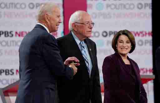 Democratic U.S. presidential candidate and former Vice President Joe Biden greets Senator Bernie Sanders as Senator Amy Klobuchar looks on at the 2020 campaign debate at Loyola Marymount University in Los Angeles, California, U.S., December 19, 2019. REUTERS/Mike Blake - HP1EFCK02SG02