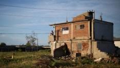 A woman washes clothes near Santa Ifigenia cemetery where the cortege carrying the ashes of Cuba's late President Fidel Castro is headed, in Santiago de Cuba, Cuba, December 4, 2016. REUTERS/Edgard Garrido - RC12C729B090