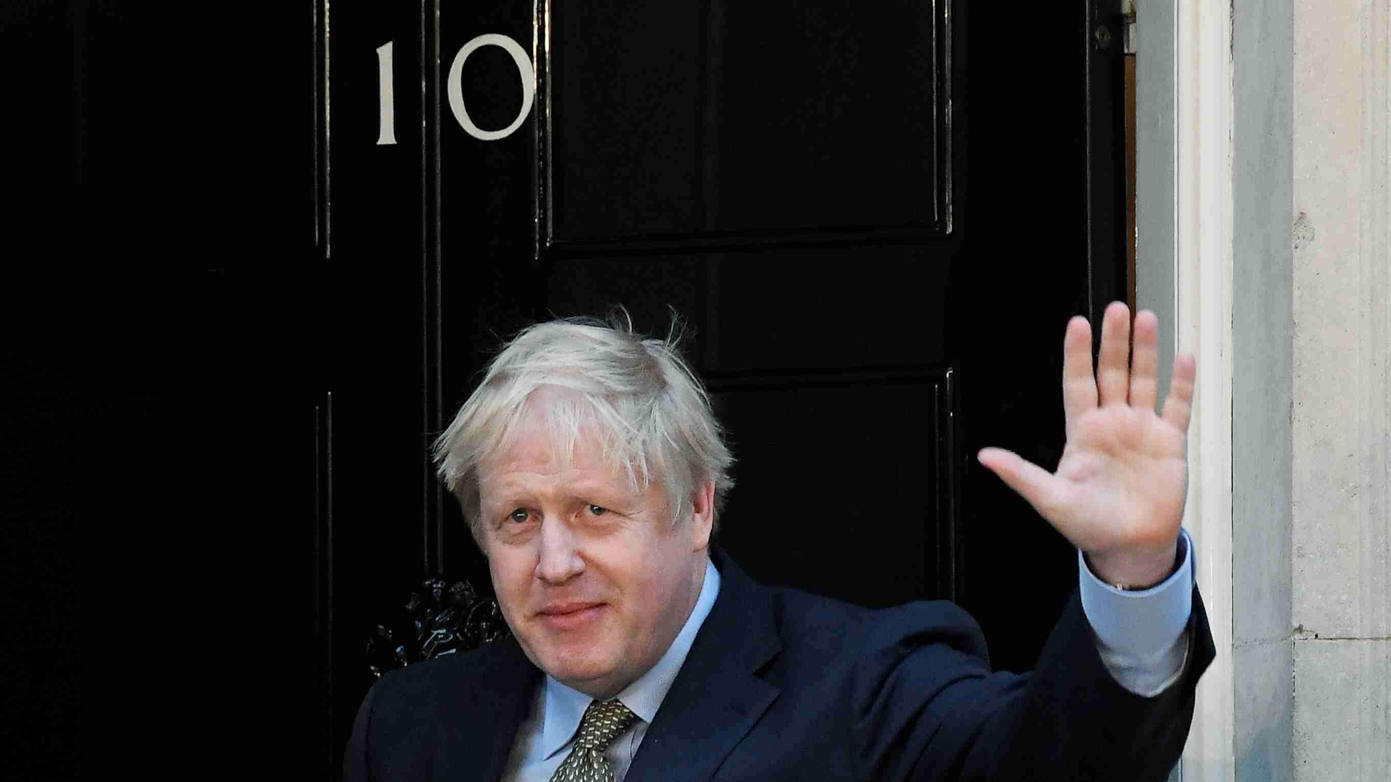 Britain's Prime Minister Boris Johnson waves after delivering a statement at Downing Street following winning the general election, in London, Britain, December 13, 2019. REUTERS/Toby Melville - RC2FUD9K5160