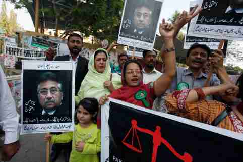 Supporters of former President Pervez Musharraf, head of the All Pakistan Muslim League (APML) political party, chant slogans during a protest demanding a fair trial for him in Karachi March 9, 2014. Musharraf is facing treason charges in a special court in Islamabad. The charges relate to his imposition of a state of emergency in 2007, when he was manoeuvring to extend his rule in the face of growing opposition from the public and the judiciary. REUTERS/Akhtar Soomro  (PAKISTAN - Tags: POLITICS CIVIL UNREST CRIME LAW) - GM1EA391JBG01