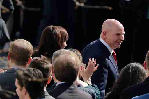 Staff gather as outgoing National Security Adviser H.R. McMaster walks out of the White House during his last day on the job in Washington, D.C., U.S. April 6, 2018. REUTERS/Carlos Barria
