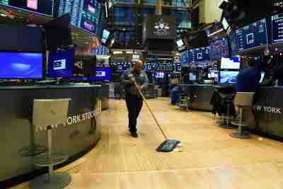 A maintenance worker sweeps the floor after the cling bell at the New York Stock Exchange (NYSE) in New York, U.S., December 31, 2019. REUTERS/Bryan R Smith