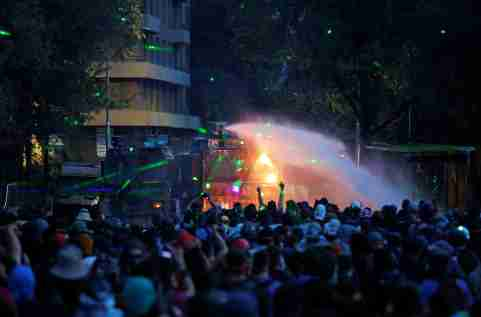 Demonstrators clash with a security forces' water cannon during a protest against Chile's government in Santiago, Chile January 10, 2020. REUTERS/Ivan Alvarado