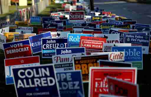 Campaign signs are seen outside a polling station on the last day of early voting in Dallas, Texas, U.S., November 2, 2018. REUTERS/Mike Segar