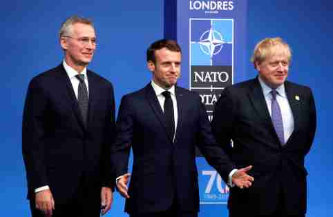 NATO Secretary General Jens Stoltenberg and Britain's Prime Minister Boris Johnson welcome France's President Emmanuel Macron at the NATO leaders summit in Watford, Britain December 4, 2019. REUTERS/Christian Hartmann/Pool