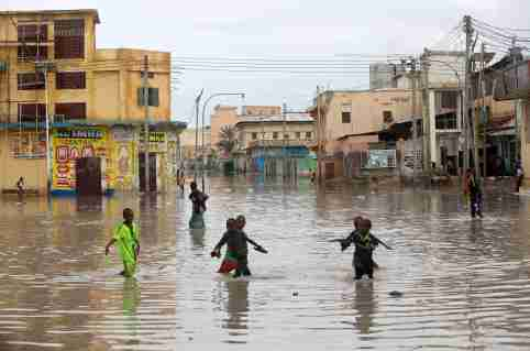 FILE PHOTO: Children play in a flooded street in Hamerweyne district of Mogadishu, Somalia May 20, 2018. REUTERS/Feisal Omar/File Photo