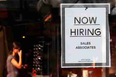 """A """"Now Hiring"""" sign hangs on the door to the Urban Outfitters store at Quincy Market in Boston, Massachusetts September 5, 2014. U.S. employers hired the fewest number of workers in eight months in August and more Americans gave up the hunt for jobs, providing a cautious Federal Reserve with more reasons to wait longer before raising interest rates.  Nonfarm payrolls increased 142,000 last month after expanding by 212,000 in July, the Labor Department said on Friday. The jobless rate fell one-tenth of a percentage point to 6.1 percent, partly because people dropped out of the labor force.    REUTERS/Brian Snyder   (UNITED STATES - Tags: BUSINESS EMPLOYMENT)"""