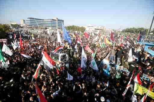 Iraqi people gather during a funeral procession for militia commander Abu Mahdi al-Muhandis, who was killed by U.S. air strike at Baghdad airport, in Basra, Iraq, January 7, 2020. REUTERS/Essam al-Sudani