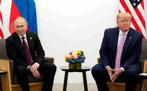 U.S. President Donald Trump meets with Russian President Vladimir Putin at the G20 Summit in Osaka, Japan June 28, 2019.  REUTERS/Kevin Lamarque - RC1455EA2DC0