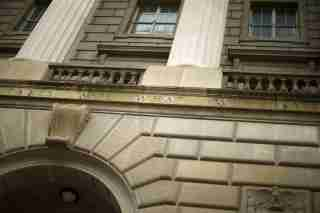 """A general view of the U.S. Internal Revenue Service (IRS) building, with the partial quote """"taxes are what we pay,"""" in Washington May 27, 2015. Tax return information for about 100,000 U.S. taxpayers was illegally accessed by cyber criminals over the past four months, U.S. IRS Commissioner John Koskinen said on Tuesday, the latest in a series of data thefts that have alarmed American consumers. The entire quote chiseled on the building, from Oliver Wendell Holmes, reads, """"Taxes are what we pay for a civilized society''. REUTERS/Jonathan Ernst"""