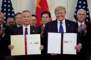 """U.S. President Donald Trump stands Chinese Vice Premier Liu He after signing """"phase one"""" of the U.S.-China trade agreement in the East Room of the White House in Washington, U.S., January 15, 2020. REUTERS/Kevin Lamarque TPX IMAGES OF THE DAY"""