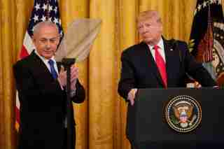 Israel's Prime Minister Benjamin Netanyahu applauds as he and U.S. President Donald Trump deliver joint remarks on a Middle East peace plan proposal in the East Room of the White House in Washington, U.S., January 28, 2020. REUTERS/Joshua Roberts