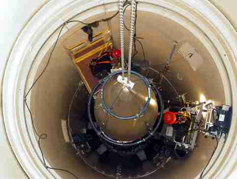 A US Air Force missile maintenance team removes the upper section of an intercontinental ballistic missile with a nuclear warhead in an undated USAF photo at Malmstrom Air Force Base, Montana. Reviews of the U.S. nuclear arsenal show significant changes are needed to ensure the security and effectiveness of the force, a Defense Department report said November 14, 2014.  REUTERS/USAF/Airman John Parie/handout via Reuters (UNITED STATES - Tags: MILITARY POLITICS) FOR EDITORIAL USE ONLY. NOT FOR SALE FOR MARKETING OR ADVERTISING CAMPAIGNS. THIS IMAGE HAS BEEN SUPPLIED BY A THIRD PARTY. IT IS DISTRIBUTED, EXACTLY AS RECEIVED BY REUTERS, AS A SERVICE TO CLIENTS