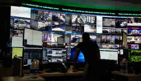 The Detroit Free Press takes a look at the preparedness, in light of mass shootings, of the Detroit Police department's Crime Intel Unit Friday, Aug. 9, 2019, which does counter terrorism threat assessments. A crime analyst looks over several different surveillance cameras positioned around Detroit.Detroitpolice 080919 01 Mw