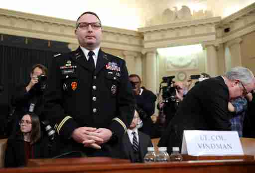 FILE PHOTO: Lt. Colonel Alexander Vindman, director for European Affairs at the National Security Council, arrives to testify before a House Intelligence Committee hearing as part of the impeachment inquiry into U.S. President Donald Trump on Capitol Hill in Washington, U.S., November 19, 2019. REUTERS/Jonathan Ernst/File Photo