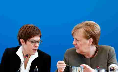 German Chancellor Angela Merkel and German Defense Minister Annegret Kramp-Karrenbauer speak during a CDU board meeting at the party's headquarters in Berlin, Germany, February 24, 2020. REUTERS/Michele Tantussi
