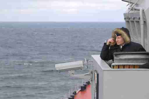 Russian President Vladimir Putin watches a navy exercise and the test launches of nuclear-capable Kinzhal and Kalibr missiles, on board of the Russian Northern fleet's Marshal Ustinov missile cruiser, in the Black Sea off Crimea's coast.