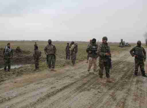 Afghan National Army (ANA) soldiers arrive at the site of last night clashes between Taliban and Afghan forces in Kunduz, Afghanistan March 4, 2020 REUTERS/Stringer        NO RESALES. NO ARCHIVES.