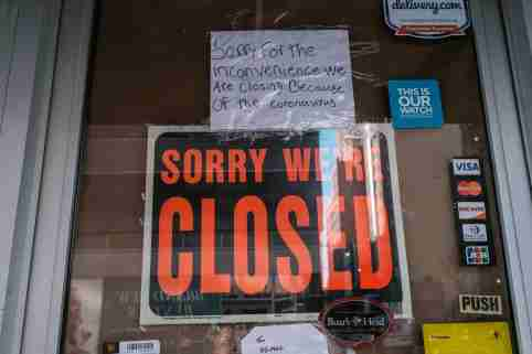 FILE PHOTO: A deli is seen closed, due to the outbreak of the coronavirus disease (COVID-19) in the Brooklyn borough of New York City, U.S., March 26, 2020. REUTERS/Stephen Yang/File Photo