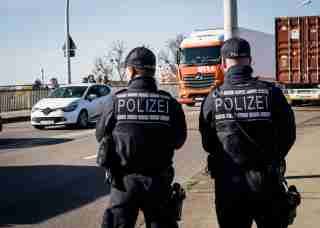 German police officers stand at the French-German border between Kehl and Strasbourg, on March 16, 2020 in Kehl, as part of border control operations. Germany has reintroduced border controls with France, Austria, Switzerland, Luxemburg and Denmark from March 16, 2020 due to the coronavirus crisis, interior minister Horst Seehofer said the day before.