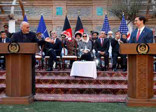 Afghanistan's President Ashraf Ghani speaks as U.S. Defense Secretary Mark Esper looks on during a news conference in Kabul, Afghanistan February 29, 2020.REUTERS/Mohammad Ismail