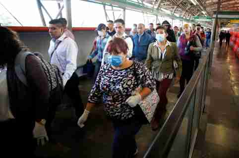 A commuter wearing a protective face mask walks inside metro installations as the outbreak of coronavirus disease (COVID-19) continues, in Mexico City, Mexico March 24, 2020. REUTERS/Gustavo Graf
