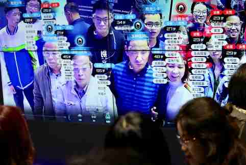 Visitors are seen at a screen displaying facial recognition technology at the Digital China Exhibition in Fuzhou, Fujian province, China May 8, 2019. China Daily via REUTERS  ATTENTION EDITORS - THIS IMAGE WAS PROVIDED BY A THIRD PARTY. CHINA OUT. NO COMMERCIAL OR EDITORIAL SALES IN CHINA. - RC155F050BE0