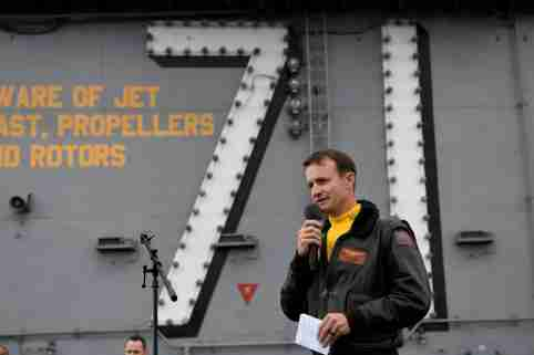 REFILE - CORRECTING YEAR Captain Brett Crozier, commanding officer of the U.S. Navy aircraft carrier USS Theodore Roosevelt, addresses the crew during an all-hands call on the ship's flight deck in the eastern Pacific Ocean December 19, 2019. Picture taken December 19, 2019. U.S. Navy/Mass Communication Specialist 3rd Class Nicholas Huynh/Handout via REUTERS.  THIS IMAGE HAS BEEN SUPPLIED BY A THIRD PARTY.